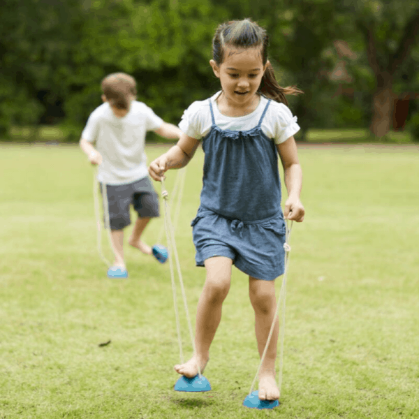 child playing with plantoys walking cups